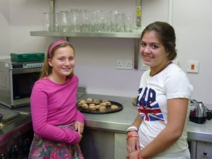 Student with an English friend learning how to make scones