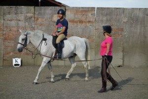 Spanish student having a riding lesson at Glapthorn Riding Stables